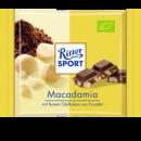Foto Ciocolata Ecologica cu Lapte si Bucati de Nuci Macadamia Ritter Sport 65g